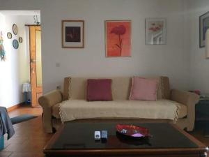 A seating area at Violet Bedroom and Apartment