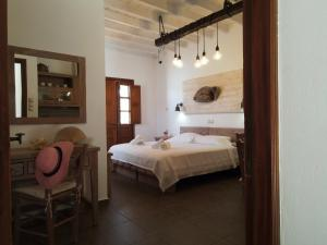 A bed or beds in a room at Mistral-Patmos