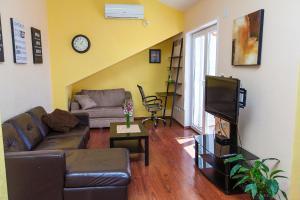 A seating area at Apartments Villa Americana