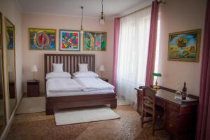 A bed or beds in a room at Hotel Bojnický Vínny Dom