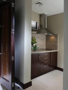 A kitchen or kitchenette at Millennium Plaza Hotel