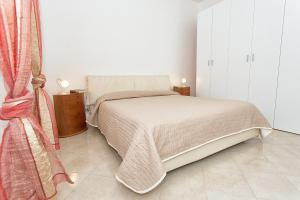 Letto o letti in una camera di B&B Villa Seta