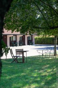 The swimming pool at or near Hôtel Restaurant Au Relais D'Alsace