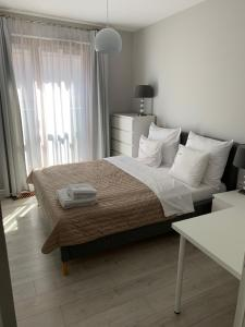 A bed or beds in a room at EXCLUSIVE Aparthotel