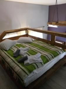 Кровать или кровати в номере Гостиный Двор Нехачево