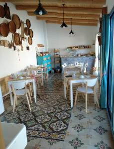 A restaurant or other place to eat at Torremana