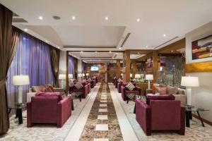Um restaurante ou outro lugar para comer em Boudl Al-Maidan