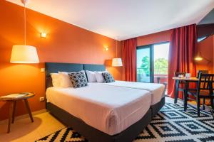 Cama o camas de una habitación en Topazio Mar Beach Hotel & Apartments