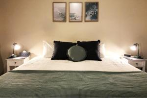 A bed or beds in a room at Observatory Guesthouse - Adults Only