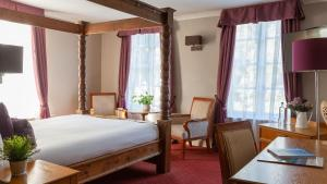 A bed or beds in a room at Muthu Clumber Park Hotel and Spa