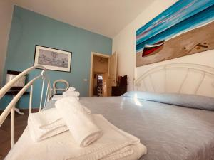 A bed or beds in a room at Aparthotel Palazzo PANTALEO