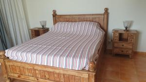 A bed or beds in a room at Casa Cereja 'Adults only'