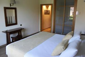 A bed or beds in a room at Don Paco