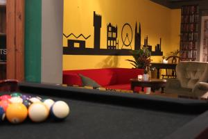 A pool table at Hostel Roots