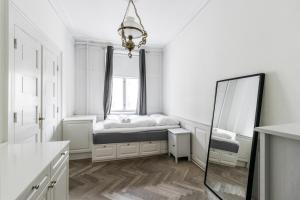 A bed or beds in a room at Heart of CPH · 172SQM · Next to DK parliament · Luxury