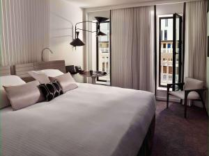 A bed or beds in a room at Molitor Paris - MGallery