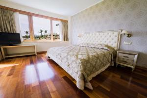 A bed or beds in a room at Kandia's Castle Resort & Thalasso Nafplio