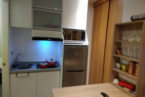 A kitchen or kitchenette at Barranc Group Penthouse