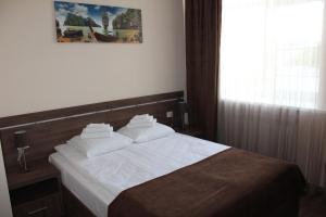 Кровать или кровати в номере Гостиница ОКА