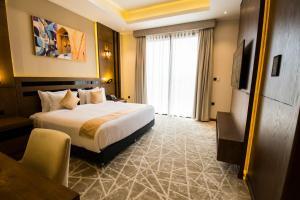 سرير أو أسرّة في غرفة في منتجع بلاد بونت