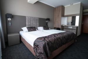 A bed or beds in a room at Bellevue Park Hotel Riga