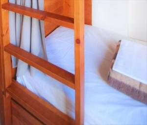 A bunk bed or bunk beds in a room at Ten To Go Hostel
