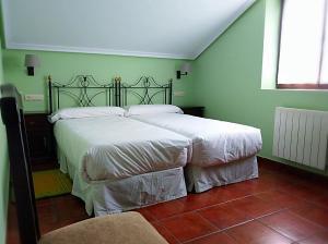Cama o camas de una habitación en Hotel Rural El Otero