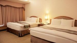 A bed or beds in a room at Zhong Ke Hotel