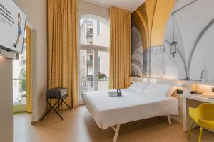 A bed or beds in a room at B&B Hotel Treviso