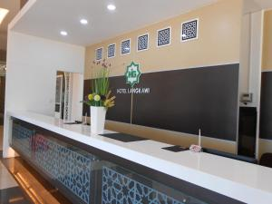 The lobby or reception area at HIG Hotel