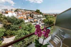 A balcony or terrace at Hotel Cronos