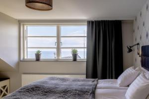 Säng eller sängar i ett rum på Bongska Huset