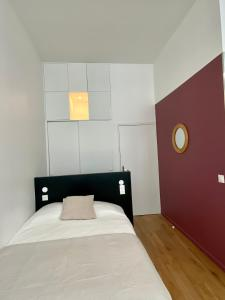 A bed or beds in a room at Apartment Aboukir 2