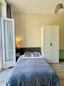 A bed or beds in a room at Apartment Poisson 3