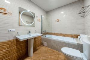 Ванная комната в Апартаменты в Олимпийском Парке