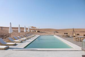 Piscine de l'établissement Emeraude Luxury Camp ou située à proximité