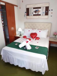 A bed or beds in a room at Pousada Spa Alto da Serra