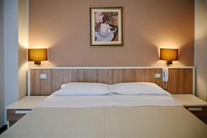 A bed or beds in a room at Stella del Sud