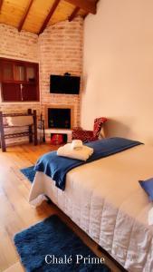 Cama ou camas em um quarto em Pousada Bosque
