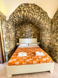 A bed or beds in a room at ANTICA TENUTA CELOTTO