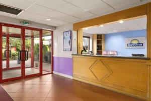 The lobby or reception area at Days Inn Hamilton