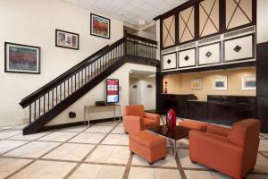 The lobby or reception area at Ramada by Wyndham Newark/Wilmington