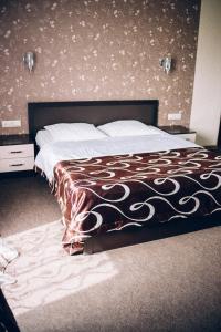 Кровать или кровати в номере Гостиница Ривьера