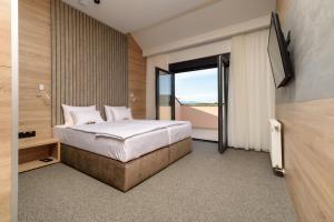 Krevet ili kreveti u jedinici u objektu Holiday Park Zagyland