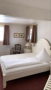 Ein Bett oder Betten in einem Zimmer der Unterkunft Dombäcker