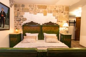 A bed or beds in a room at Palazzo Drusko Deluxe Rooms