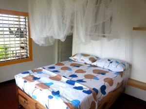 Ein Bett oder Betten in einem Zimmer der Unterkunft Germaican Hostel
