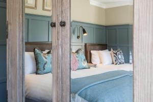 Letto o letti in una camera di The Cuan Licensed Guest Inn
