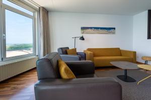 Ein Sitzbereich in der Unterkunft Strandappartementen De Gulden Stroom