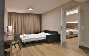 A bed or beds in a room at Ocak Hotel & Apartment